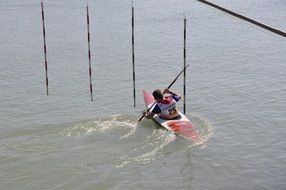 the athlete is swimming in a canoe with a paddle