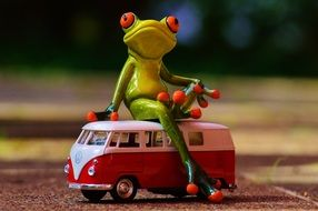 bulli frog sitting on retro volkswagen bus