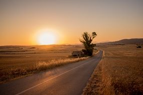 country sunset Road field view