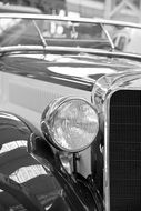 Old car spotlight black and white recording