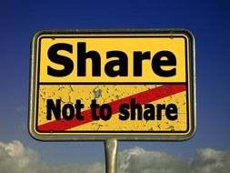 "plate with the words ""share"" and "" not to share"""