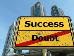 success and doubt road sign