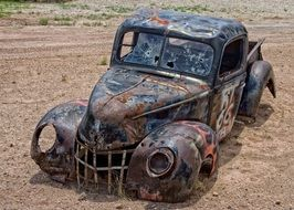 rusty pickup in the sand in arizona
