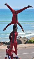 dark skin street acrobats at coast