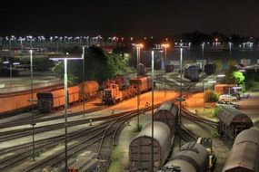 freight trains on marshalling yard at night
