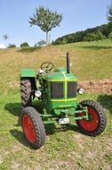 Oldtimer green tractor for agriculture