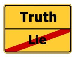"Yellow street sign ""truth"" and crossed out ""lie"""