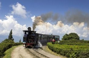 steam locomotive on railway in beautiful landscape, india, darjeeling