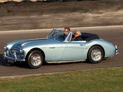 austin healey classic car with passengers