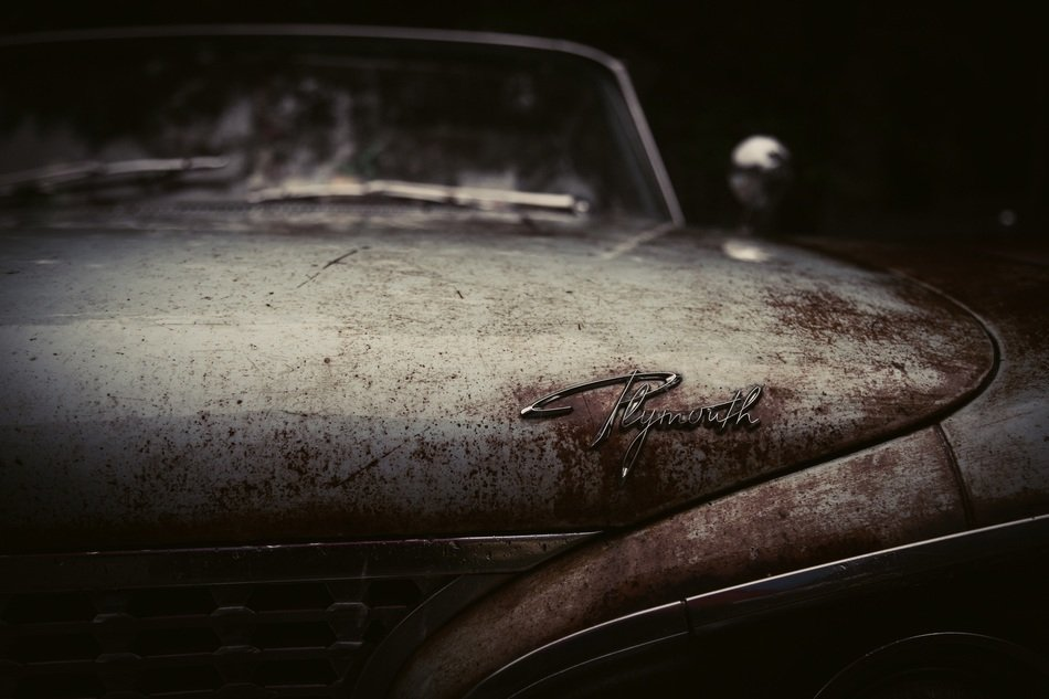 vintage rusty plymouth car