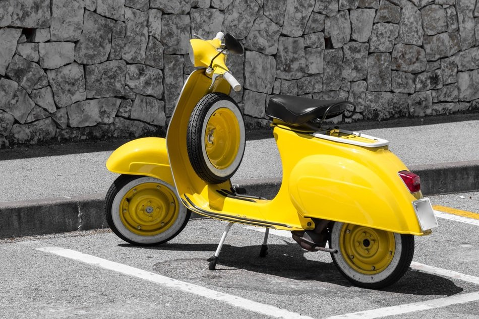 vespa yellow motor scooter classic