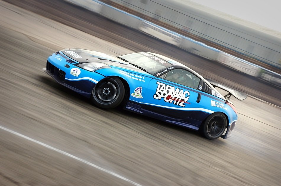 blue racing car on a blurred background