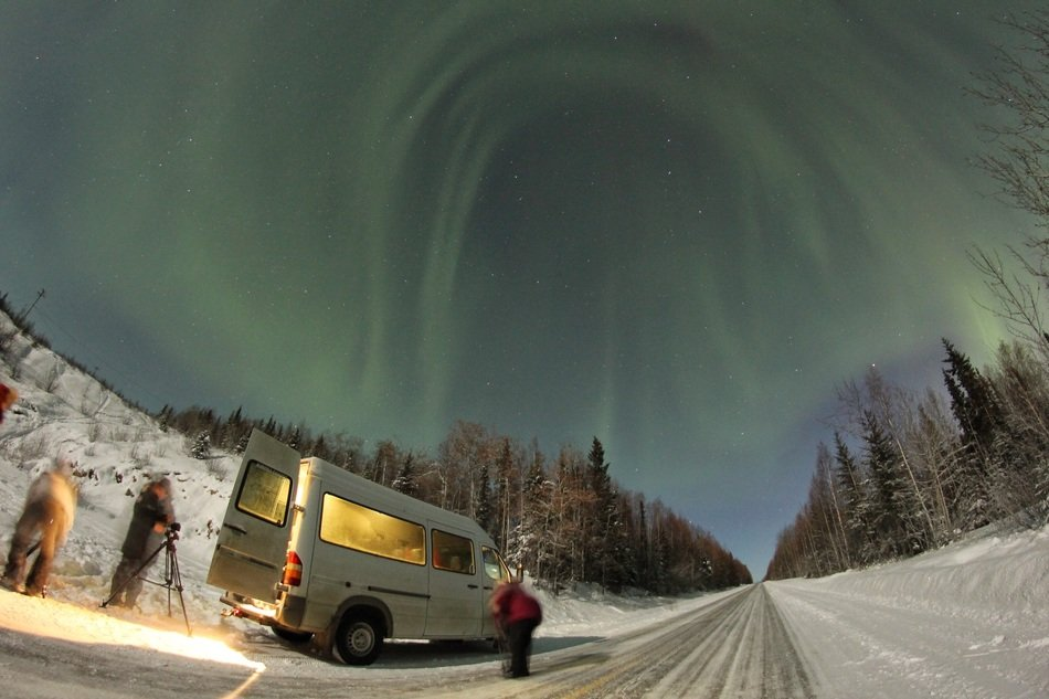 beautiful northern lights over the winter road