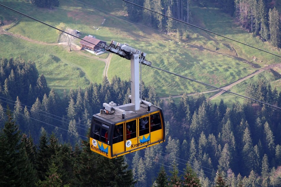gondola on the cable car above the trees