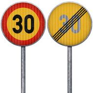 Two yellow and red maximum speed limit 30 road signs