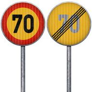 Two yellow and red maximum speed limit 70 road signs