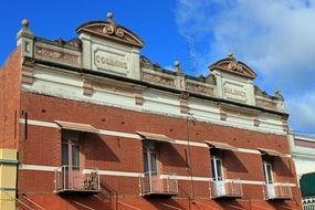 facade of a historic brick building with balconies
