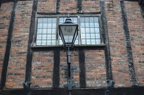 lantern on the background of the facade with a large window