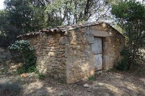 small stone house in a village