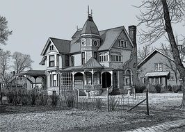 black and white photo of a two-story house