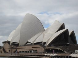concert building of opera house at clouds, australia, sydney