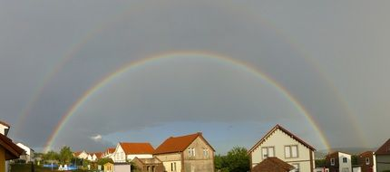 double rainbow above village