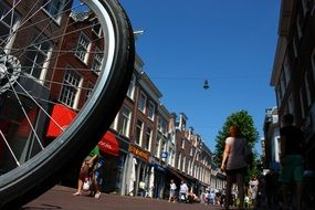 a bicycle wheel on a central city street in Holland