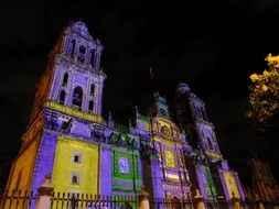 Colorful illuminated Mexico City Metropolitan Cathedral at night, Mexico