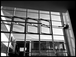 black and white photo of large glass windows at a factory in Dessau
