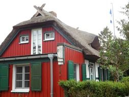 red house with reed roof on the Baltic Sea