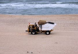 sweeper on the beach