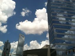 clouds are reflected in the mirror facades