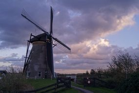 Windmill among the rural landscape in Holland