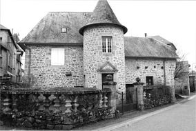 french stone house with turret, black and white