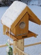 bird seed house covered by snow