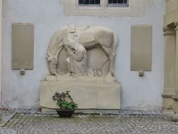 soldier with horse, stone sculpture in World War II memorial, germany, remstal