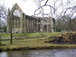 ruin of gothic abbey at river, uk, england, yorkshire