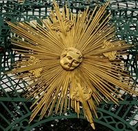 monument to the Golden sun with a face