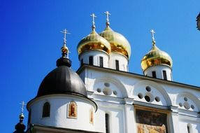 white russian church with golden onion domes