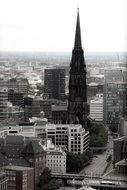 church steeple above buildings in city, black and white, germany, hamburg