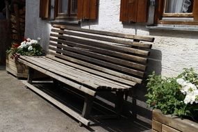 Wooden bench near the house