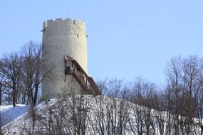 tower on a hill during a blizzard