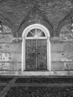 black and white photo of the door in the building