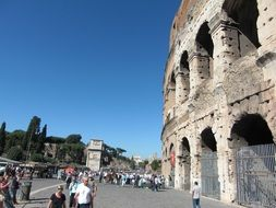 Groups of tourists by colosseum Rome Italy