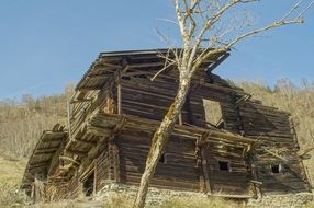 old destroyed wooden house