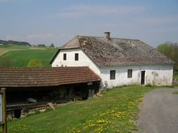 Photo of a rural house with a barn