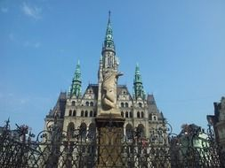 beautiful old building of city hall behind wrought iron fence, czech republic, liberec