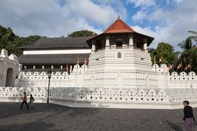 fortress with white walls and brown roof