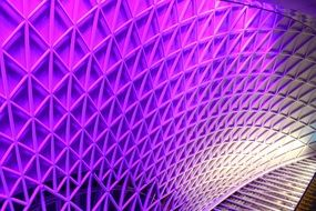 colorful illuminated roof of king's cross subway station, uk, england, london