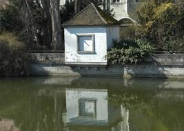 the house is reflected in the water